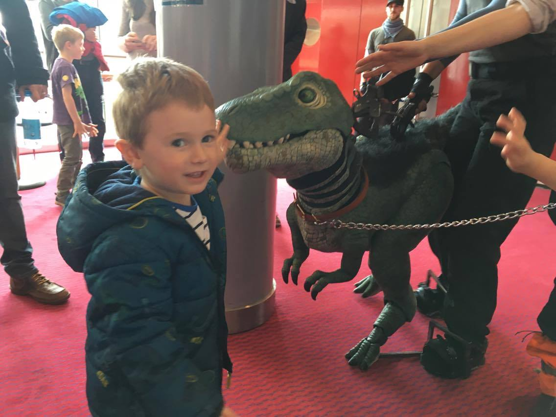 Jake next to a dinosaur