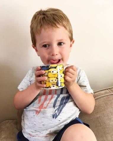 child with despicable me mug