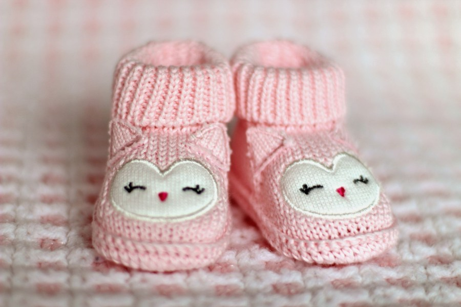 2 baby pink booties