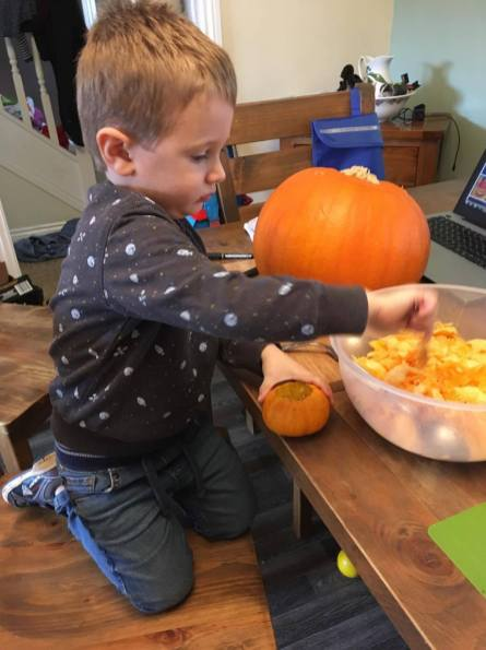 Jake cleaning out his pumpkin