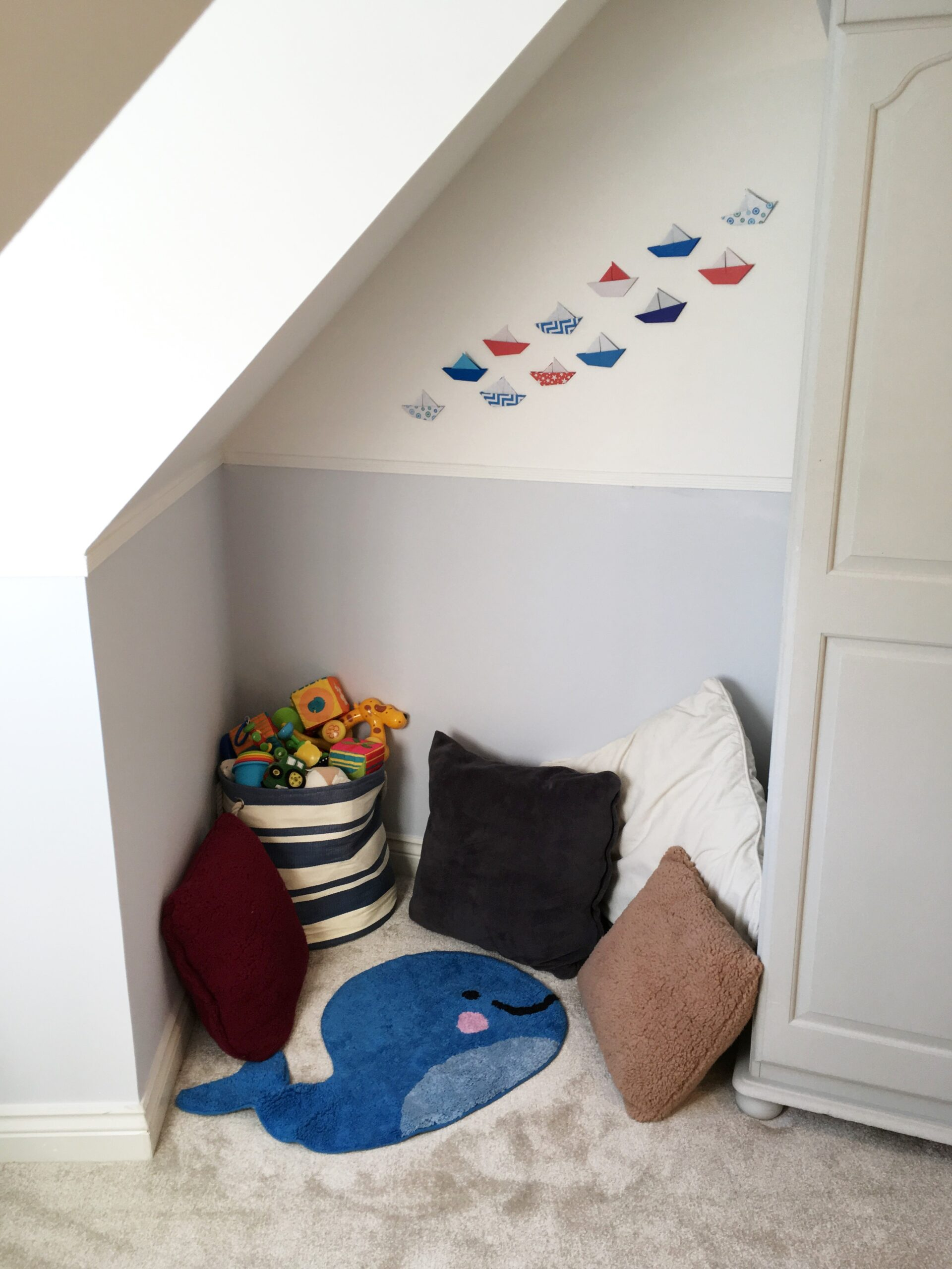 nautical look in a nursery with origami boats on the wall