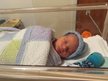 William in a hospital cot