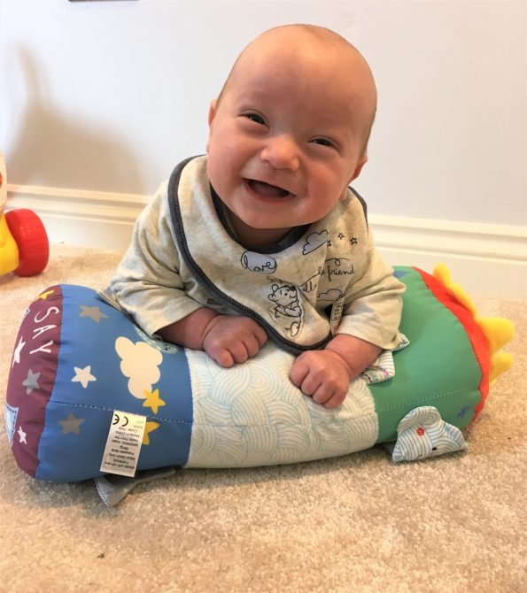 baby on the say hello tummy time discovery toy