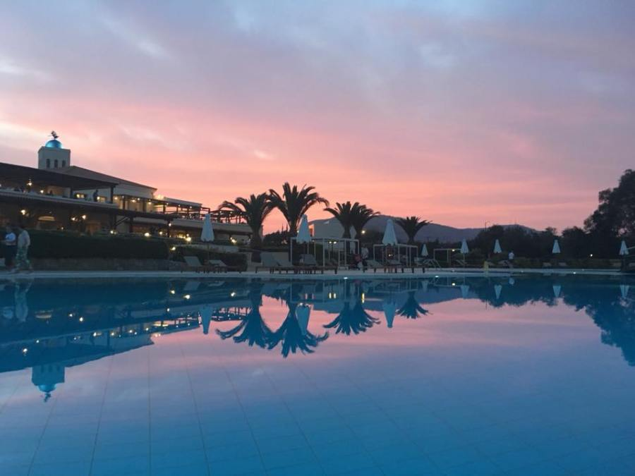 pool and hotel at sunset in Crete