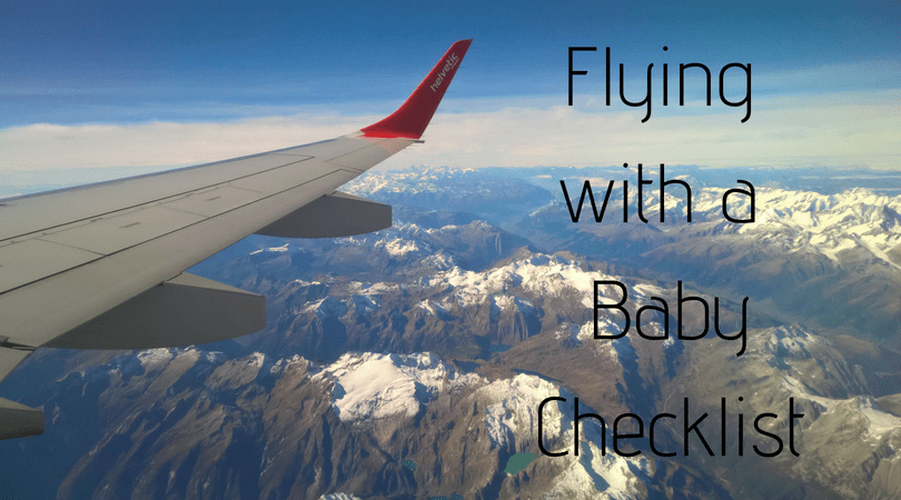 flying with a baby checklist written on a skyline with a plane