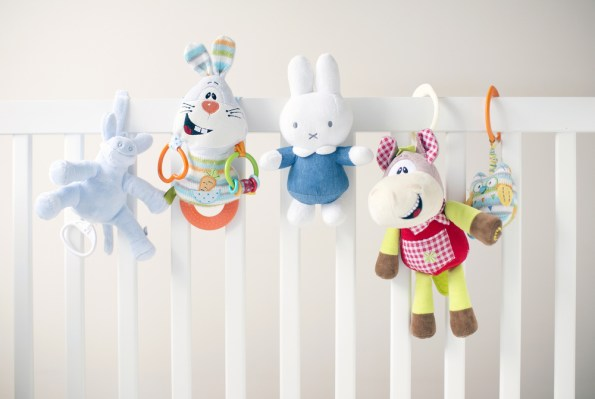 baby toys on a cot