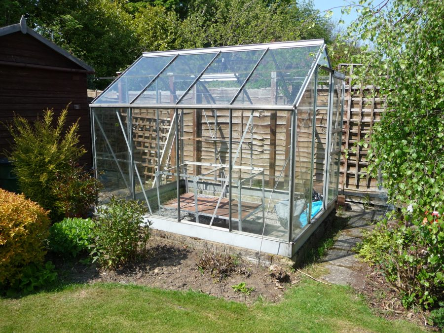 creating an attractive garden space with a greenhouse