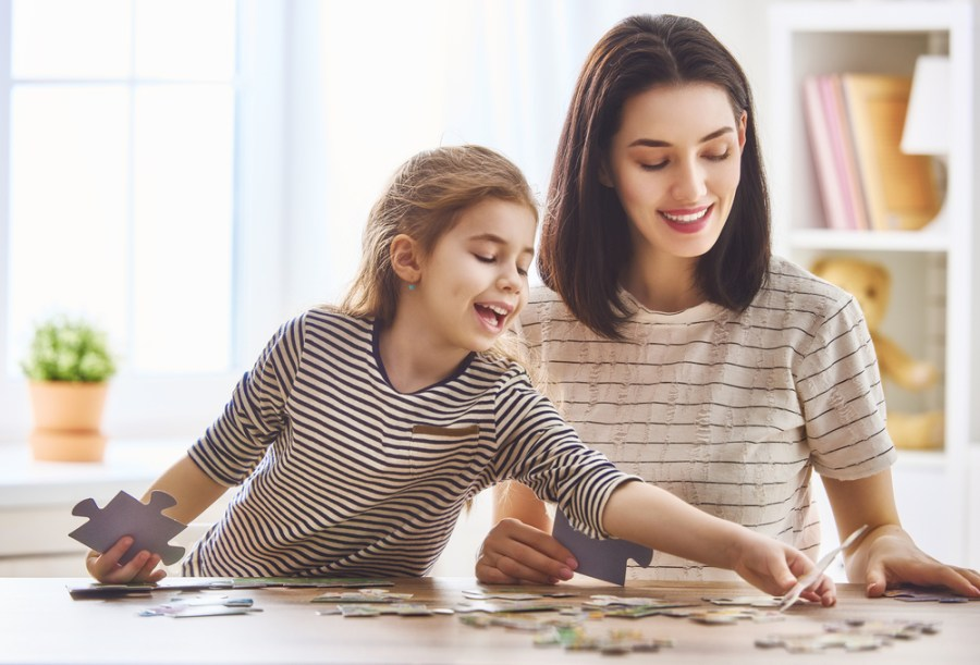 a mum and child doing a jigsaw puzzle
