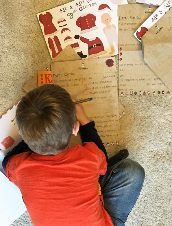 Jake filling out his santa letter. Shot from above