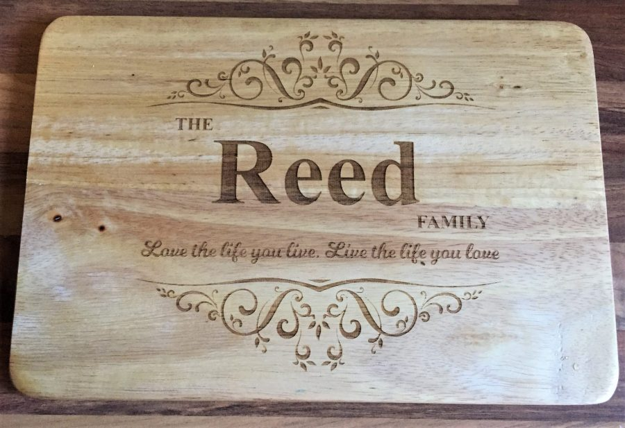 BrassBox personalised chopping board with Reed family written on it