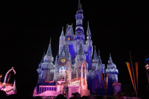 Disney castle lit up at night