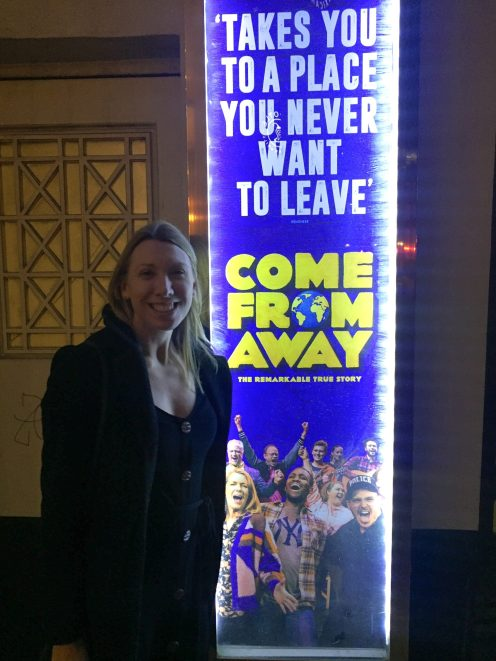 Me by the sign for come from away