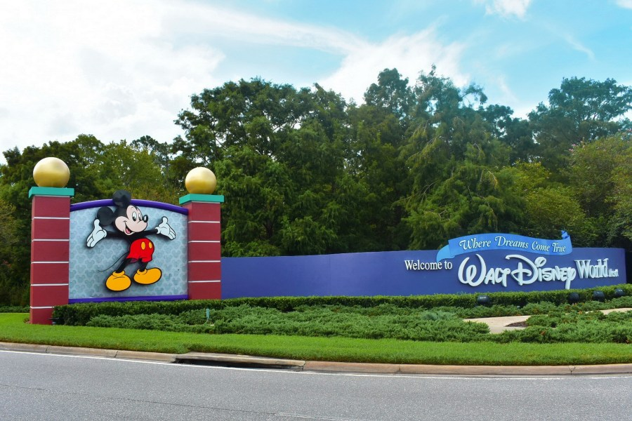 Mickey Mouse and a sign saying welcome to Walt Disney World