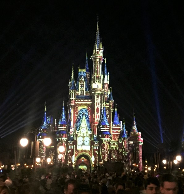 castle lit up in Beauty and the beast at the Disney firework display