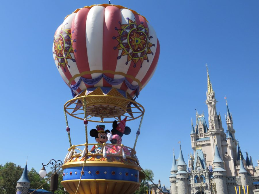 Mickey and Minnie in a hot air balloon in the parade