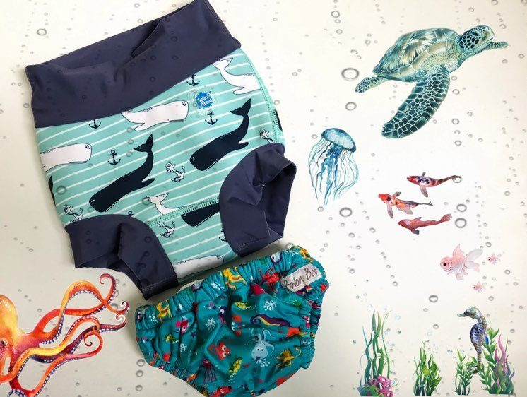 reusable swim nappies with graphics of under water animals