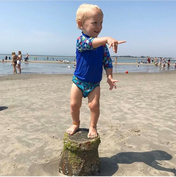William stood on the break water at the beach in his reusable swim nappy