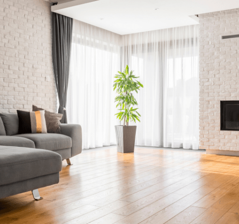 a living room with a solid wood floor
