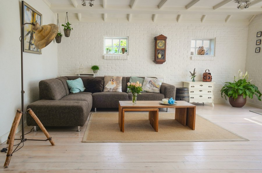 a living room with a brown sofa, rug and coffee table