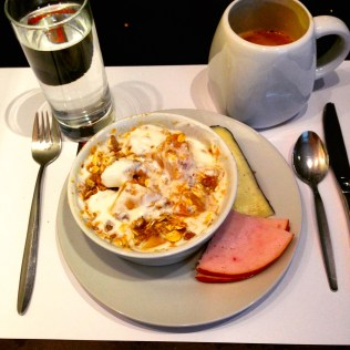 so basic, but really awesome 2 days in a row at the hotel: fresh yogurt with peaches and muesli, with a side of ham and ewe's cheese.