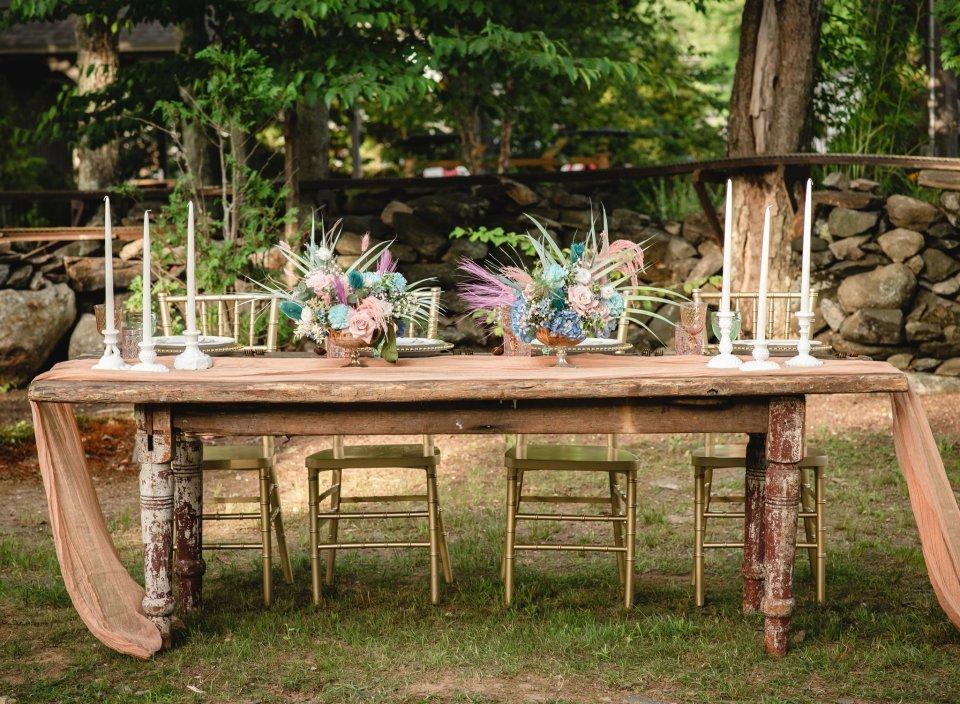 whimsical farmhouse table at backyard wedding