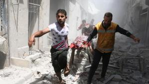 TOPSHOT - Syrian men carry a body on a stretcher amid the rubble of destroyed buildings following a reported air strike on the rebel-held neighbourhood of Al-Qatarji in the northern Syrian city of Aleppo, on April 29, 2016. Fresh bombardment shook Syria's second city Aleppo, severely damaging a local clinic as outrage grows over an earlier air strike that destroyed a hospital. The northern city has been battered by a week of air strikes, rocket fire, and shelling, leaving more than 200 civilians dead across the metropolis. The renewed violence has all but collapsed a fragile ceasefire deal that had brought an unprecedented lull in fighting since February 27. / AFP / AMEER ALHALBI (Photo credit should read AMEER ALHALBI/AFP/Getty Images)