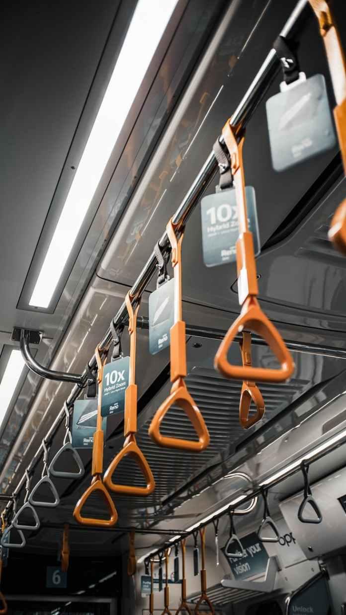 hanging orange handles in public transport