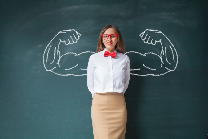 Young woman with metaphorical strong arms drawn in representing assertiveness