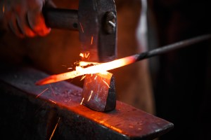 The hands of a blacksmith at work in the smithy