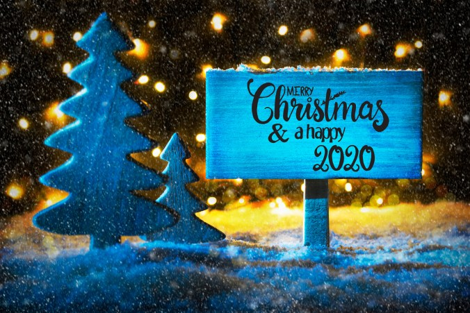 Andrew D Pope wishing you a happy Xmas and New Year for 2020. Sign With English Calligraphy Merry Christmas And A Happy 2020. Blue Christmas Tree, Snow And Lights