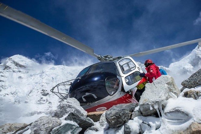 A helicopter lands during rescue efforts at Mount Everest Basecamp in Nepal after an earthquake struck, causing an avalanche. (Elia Saikaly/6summitschallenge.com)