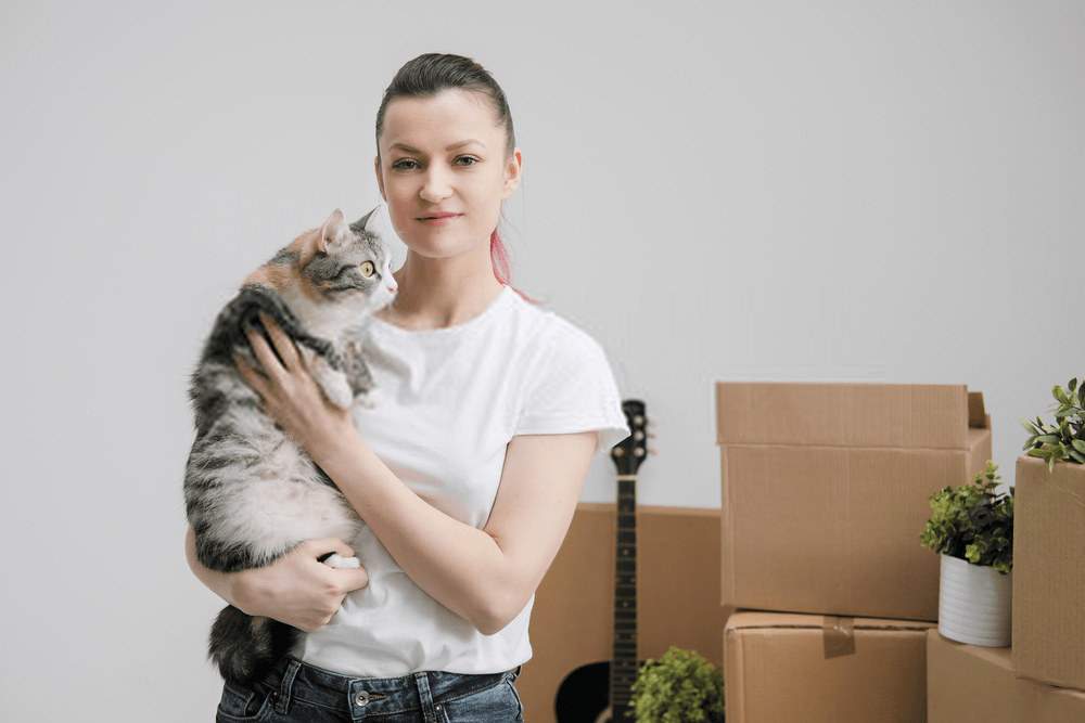 girl with cat pet relocation services