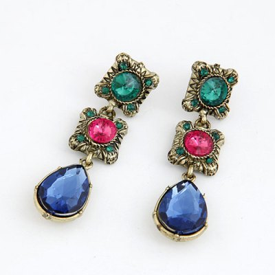 Blue green and pink gems set in antique gold