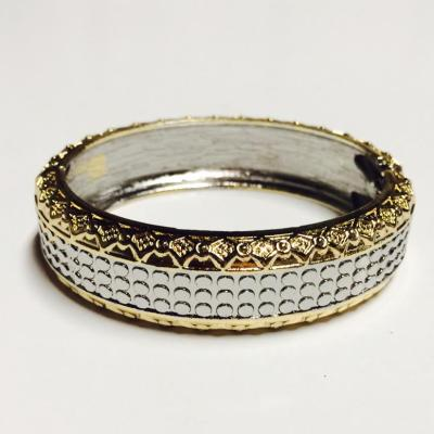 Gold and silver patterned bangle