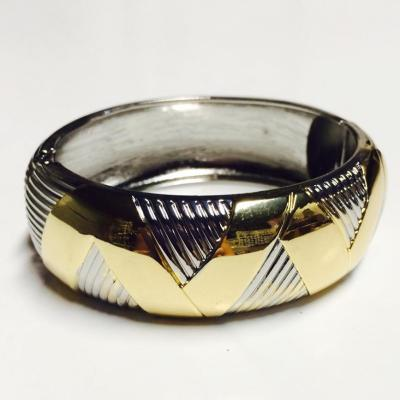 Gold and silver wide chevron style bangle