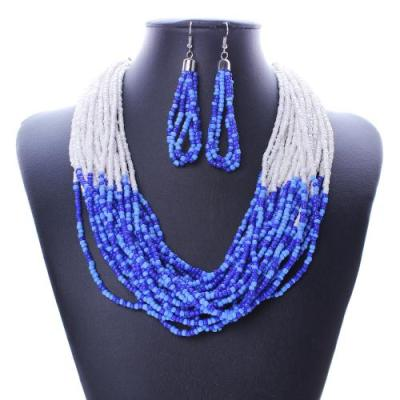 Bright blue and white beaded necklace and earring set