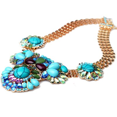 Bright blue ornate statement gem necklace in gold