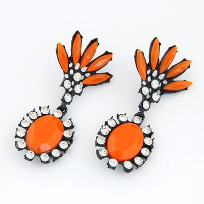 Bright statement earrings set in black in fluro orange