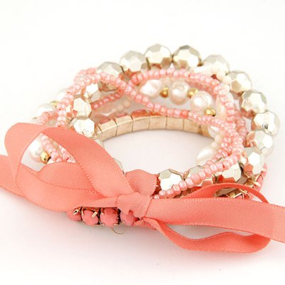 Ribbon bracelets in coral