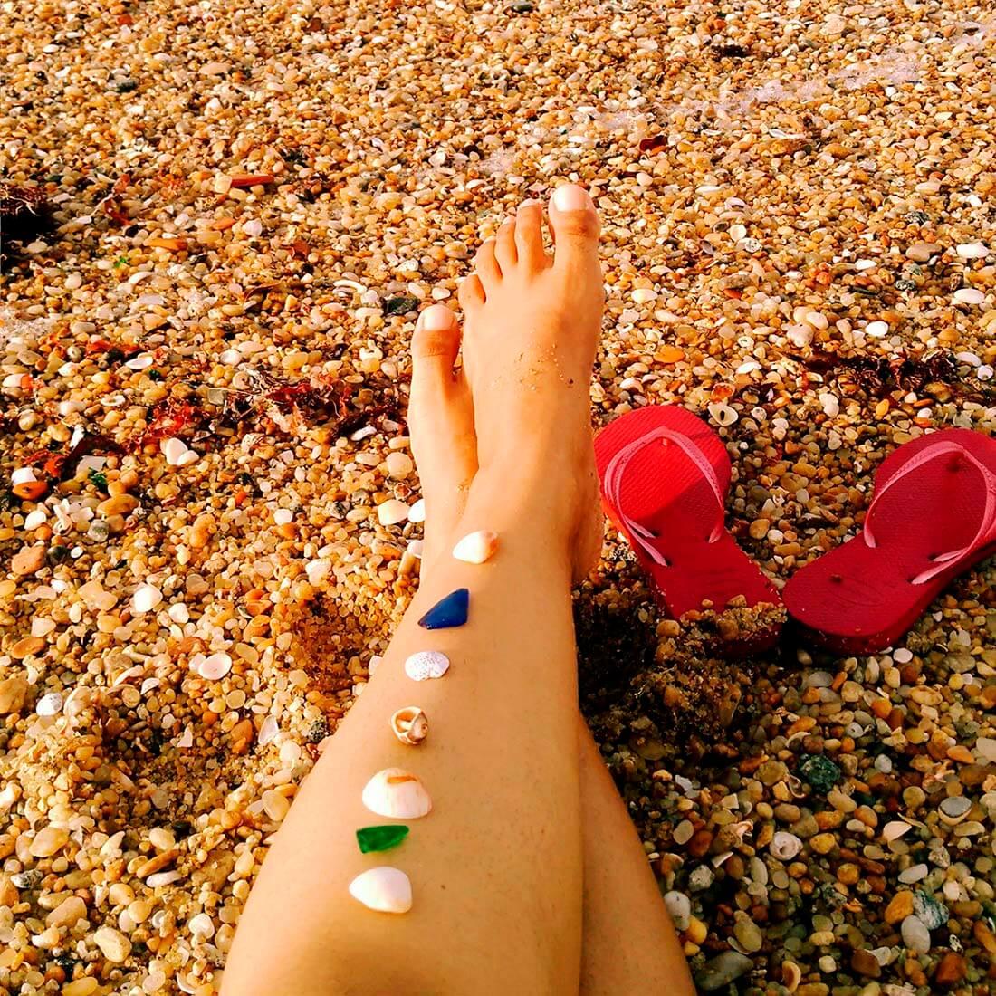 pernas na areia