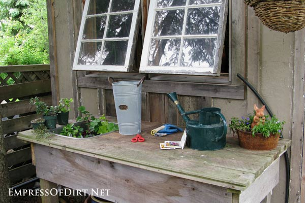 Potting table built against a wonderful barn board shed. Come visit the entire garden tour!