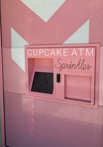 Sprinkles Cupcake ATM: A pink bundle of joy putting smiles on people's faces  3 Cupcakes and ATM's, two words not typically associated with each other in a sentence and definitely not as a thing. But it is and it is delivering an assor