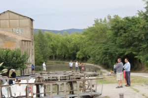 sometimes townspeople gather to watch boats go through the locks
