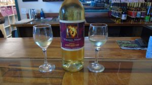 a bottle of Volcano white wine with two glasses