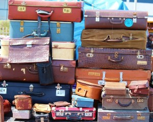 stack of assorted vintage luggage