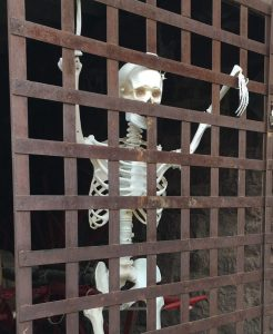 skeleton in a jail cell