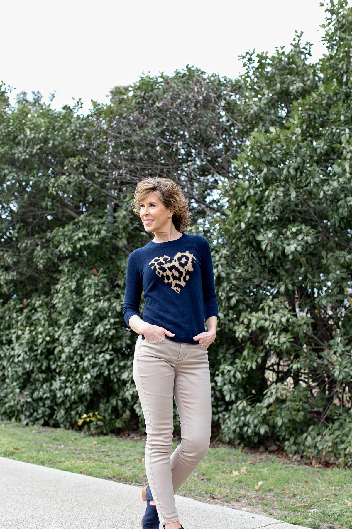 woman in heart sweater walking