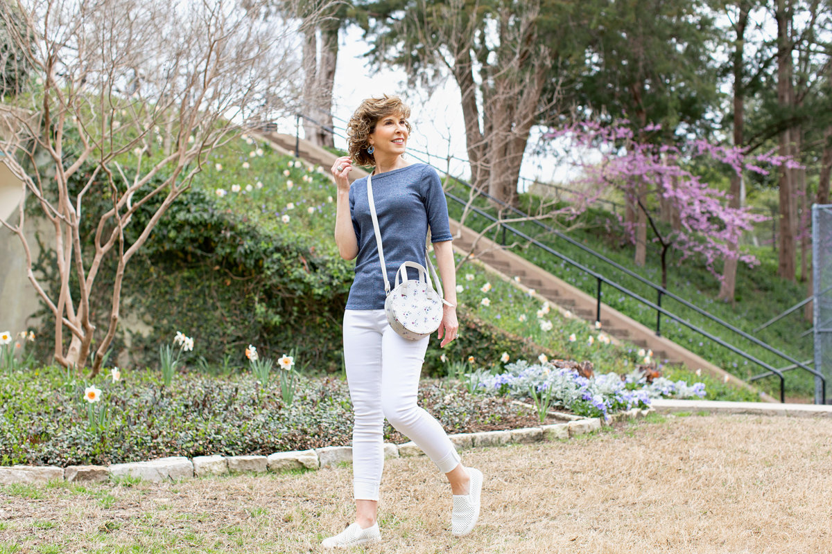 woman in blue and white outfit walking in park