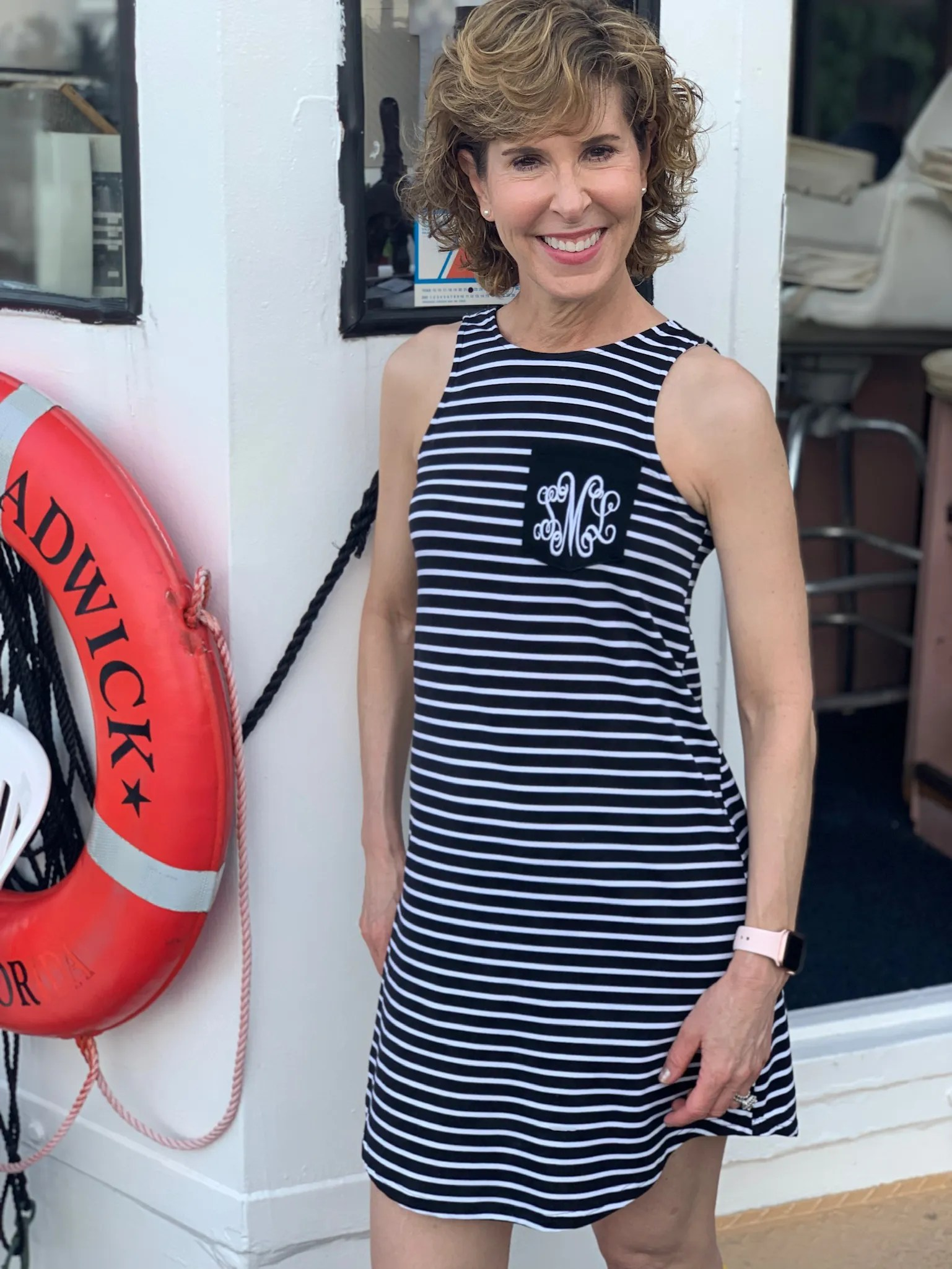 woman in black and white striped dress on the captiva cruises lady chadwick