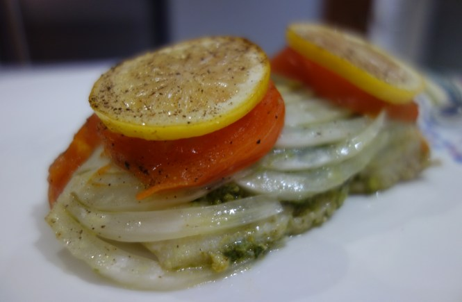 haddock fillet baked with pesto fennel tomato and lemon